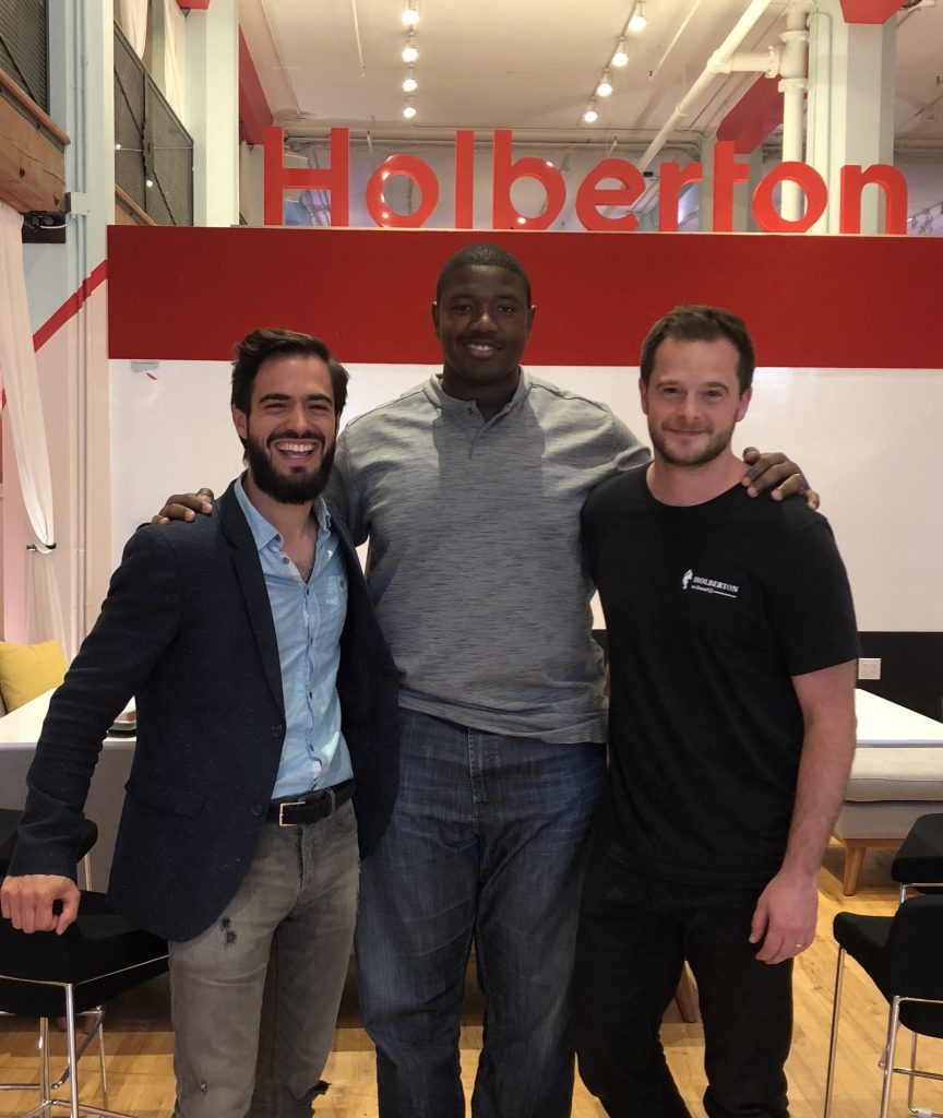 Holberton School founders and Kelvin Beachum pictured in front of the Holberton logo